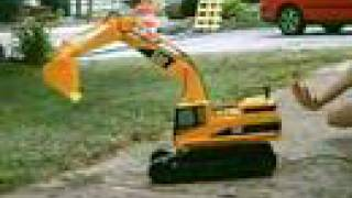 CAT Backhoe in action digging sewer Funny cute video of Remote Control R/C Miniature Cat