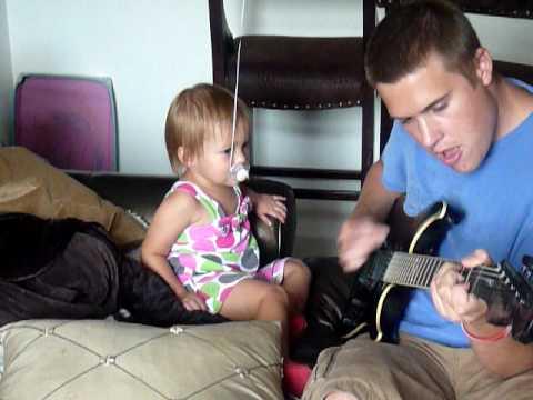 Robert Willis teaches Alyssa to play guitar