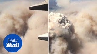 Passenger records smoke-filled sky as she flies over CA wildfire - Daily Mail