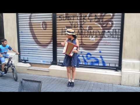 Cute Japanese singer girl in Istanbul perform famous  with accordion