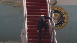 President Biden falls down walking up steps of Air Force One