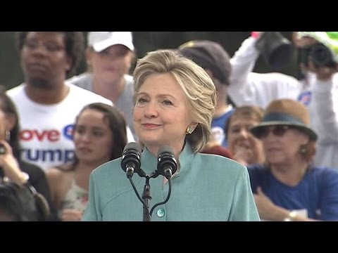 Watch: Clinton\'s rally interrupted by downpour
