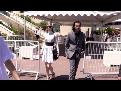 Diego Luna and Erin Moriarty coming out of the Blood Father press conference heading to Agora in Can