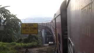 15696 AGARTALA-LUMDING MG Express cruises through the scenic section.