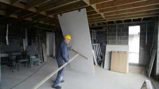 The FAST and EASY way to install a FULL SIZE sheet of plasterboard / drywall to a ceiling