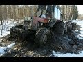 Belarus Mtz 1025 forestry tractor in wet forest