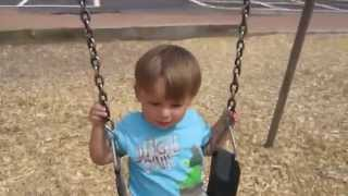 Toddler Learns To Swing