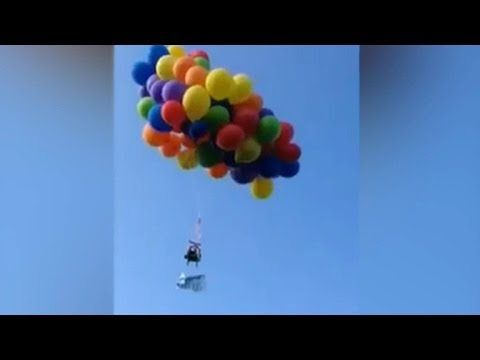 Canadian man arrested for floating lawn chair by balloon - YouTube