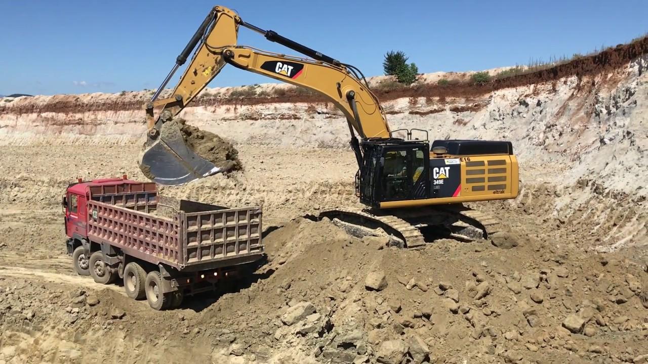 Cat 349E Excavator Loading Trucks With 4 Passes