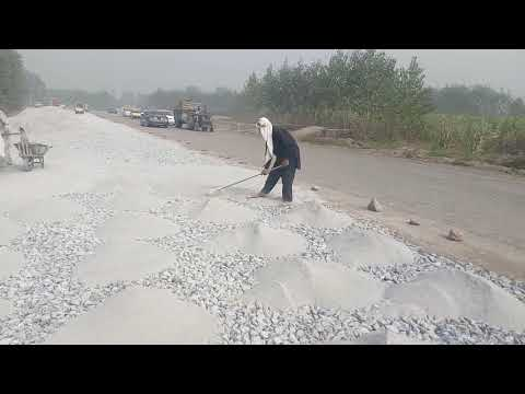 Water Bound Macadam (WBM) Road At Site Laying Stone Dust