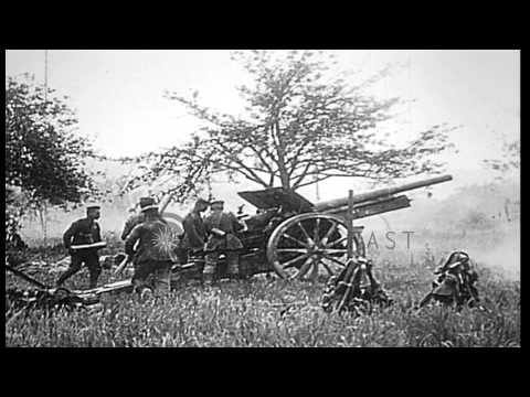German field artillery covering infantry advance during World War I HD Stock Footage