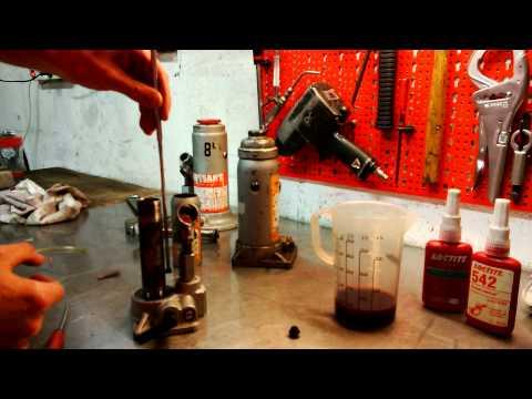 faire fonctionner un cric la tête en bas presse hydraulique
