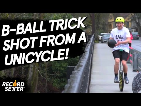 Highest Basketball Shot While Riding A Unicycle!