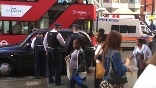 Police catch shoplifters in London Cab, Oxford St, London