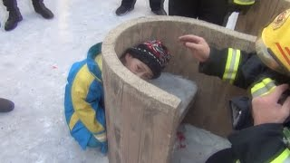 Firefighters Rescue Boy Stuck in Stone Bench