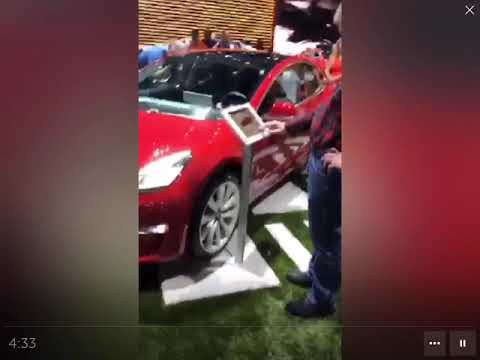 Tesla booth & Model 3 mobbed at LA Autoshow, Audi's booth empty
