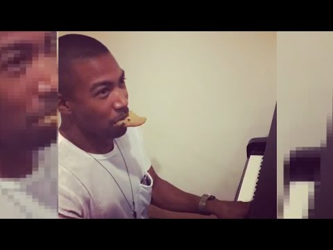Charles Michael Davis Eating A Cookie Playing Piano