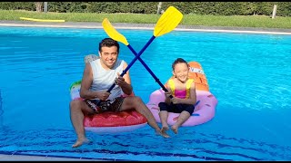 Öykü and Dad organizes a water race in the pool