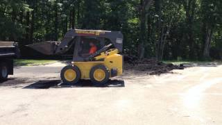 Loading mulch into the mason dump with the skid skidsteer