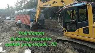 excavators loading dump trucks
