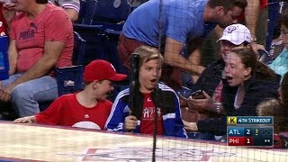 Young fan gets bat, can