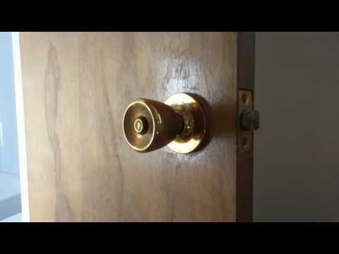 How to remove a doorknob that doesn't have exposed screws