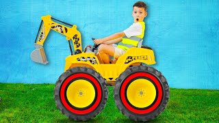 Artem playing with Power Wheels Tractor Excavator