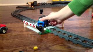 Lots of lego cars get crashed by lego train.