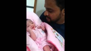 Father give Azan to her baby