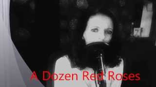 sharon covers a dozen red roses