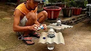 Repeat youtube video Membuat lampu botol 10 watt dari botol bekas tanpa listrik - GB green project 01