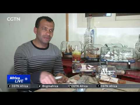 Egyptian artist creates miniature representations of ships in glass bottles
