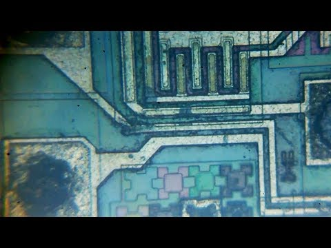 IC 555  chip's  amazing structure under a microscope (GOLD visible in chip)