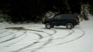jeep grand cherokee lifted in snow wj