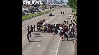 Demonstrators near Highway 288 during Friday's 'Justice for George' demonstration