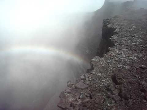 Rainbow inside a volcano crater