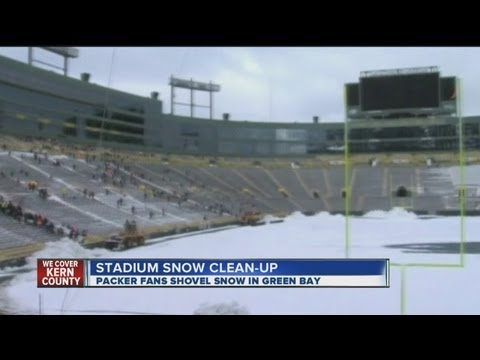 Packer fans clear snow at Lambeau Field