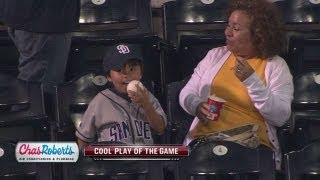 Fan generously gives his foul ball to a kid