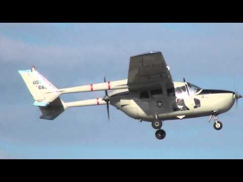Cessna 0-2A Super Skymaster N802A departing KOSH on 8/4/13 at 1806