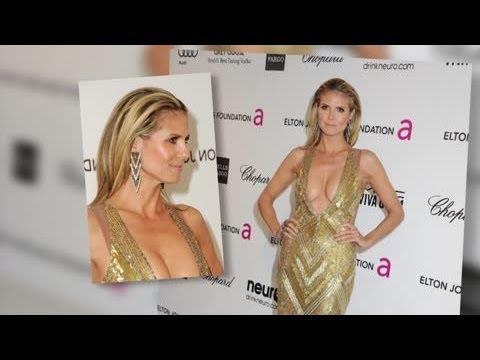 Heidi Klum Narrowly Avoids a Wardrobe Malfunction in Chest-Baring Dress at Oscar Party - Splash News