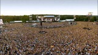 Watch Robbie Williams We Will Rock You Live video