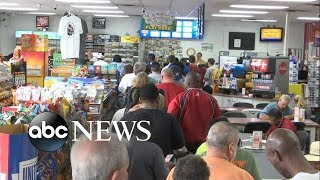 People rush out to buy lottery tickets for the now-$1.6 billion jackpot