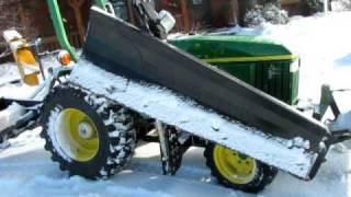 John Deere 3005 (790) Compact Utility Tractor with fabricated RH wing snow blade attachment.