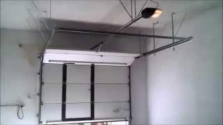 видео Подъемно-секционные гаражные ворота