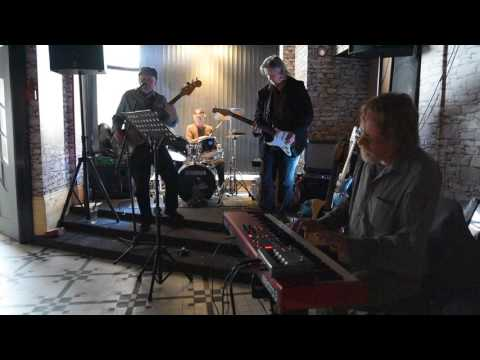 A jam with musicians playing a tribute to Henry McCullough