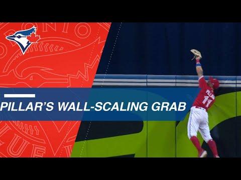 Kevin Pillar climbs wall to rob Castellanos of a home run