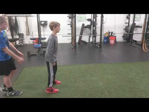 Youth Athletes working on 1st step acceleration technique