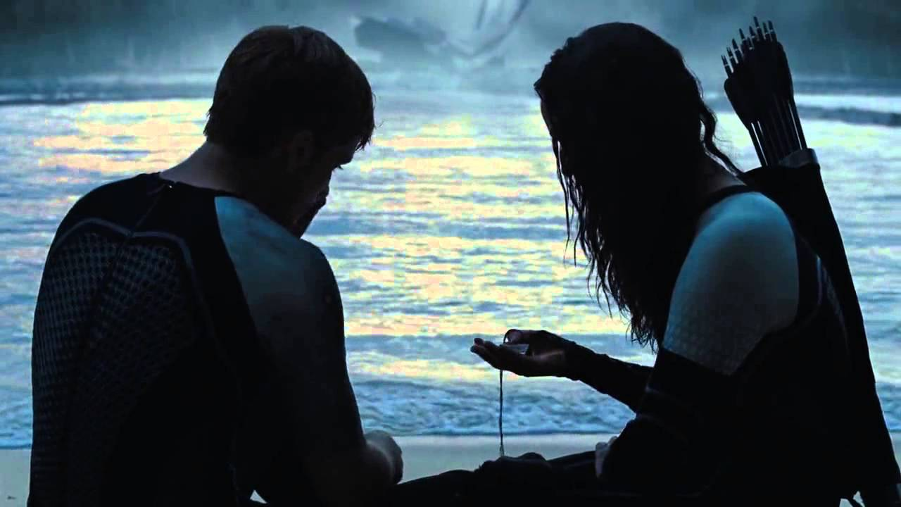 catching fire katniss and peeta kiss on the beach