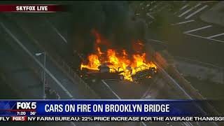 Cars burn on Brooklyn Bridge