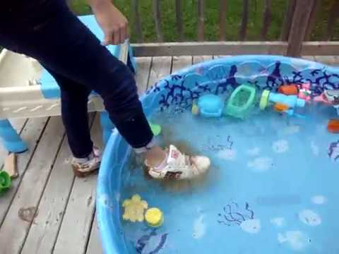 Girl DC shoes and socks mudding Then cleaning in pool